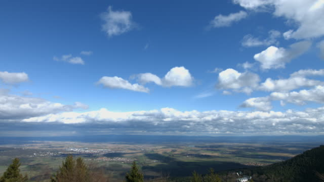 timelapse: clouds moving over the valley - horizon over land stock videos & royalty-free footage