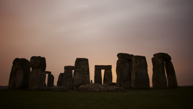 Timelapse clouds scud over prehistoric Stonehenge monument, Wiltshire, UK