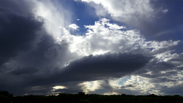 'Timelapse clouds scud overhead as sun sets, South Africa'