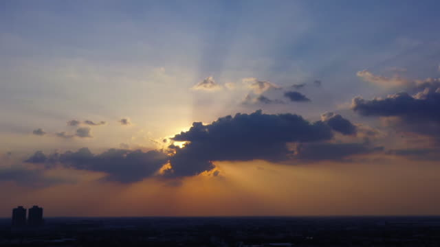4k time-lapse clouds sky scape with sunbeam. - day to night time lapse stock videos & royalty-free footage