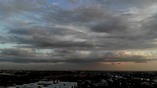 timelapse clouds skyscape over the city at sunset. - pagoda stock videos & royalty-free footage
