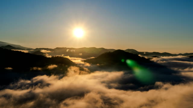 4k timelapse - cloudscape over mountains, sunrise - mountain stock videos & royalty-free footage