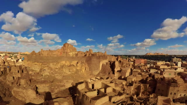 timelapse: cloudy sky over the melted shali fortress of siwa oasis - mud stock videos & royalty-free footage