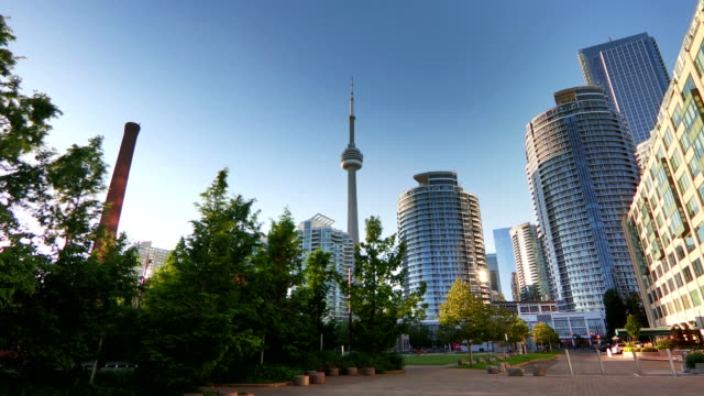 time-lapse: cn tower and residential buildings against blue sky - tall high stock videos & royalty-free footage