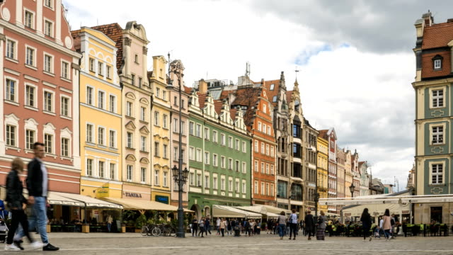 Timelapse: colorful building in market square at summer, Poland