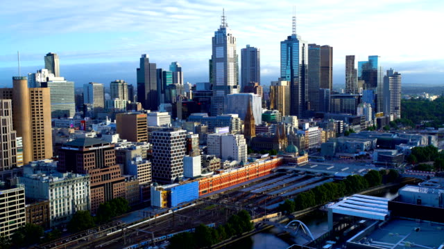timelapse commuter travel melbourne city commercial skyscrapers australia - railroad station platform stock videos & royalty-free footage
