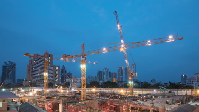 timelapse construction the buildings, day to night time lapse 4k, camera tilt up - crane stock videos & royalty-free footage
