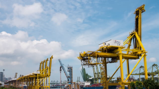 4K Time-lapse : Container Cargo freight ship working crane bridge in shipyard