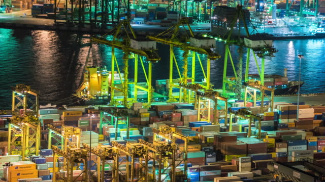 4K Time-lapse : Container Cargo freight ship working crane bridge in shipyard