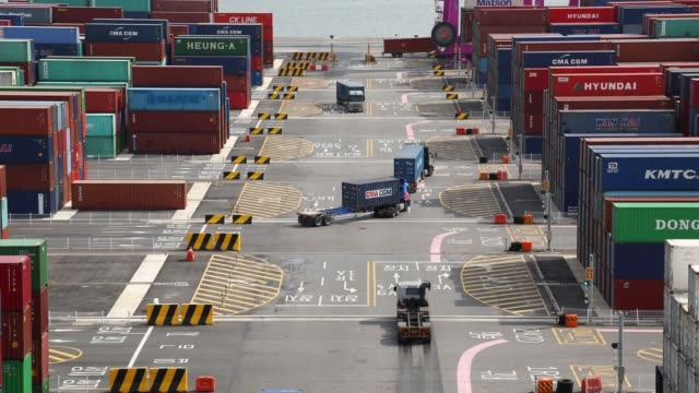 stockvideo's en b-roll-footage met timelapse container trucks drive past stacked shipping containers at the sun kwang newport container terminal in incheon new port in incheon south... - incheon