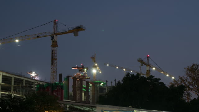 4K Timelapse: Crane in construction work.