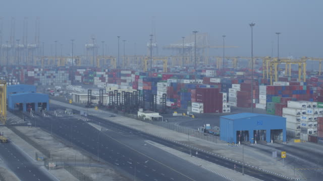 Timelapse cranes and lorries working at container port, Jebel Ali, Dubai