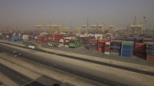 timelapse cranes and lorries working at container port, jebel ali, dubai - haulage stock videos & royalty-free footage
