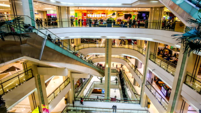 timelapse crowd at shopping mall - shopping centre stock videos & royalty-free footage