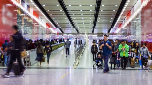4K Timelapse(4096x2160) : Crowd of people, going in and out forward, in tunnel of Central MTR subway station in Hong Kong.zoomin styles.