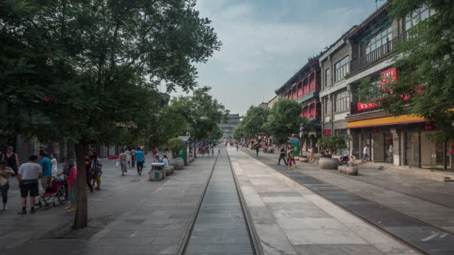 timelapse crowd of qianmen street, beijing - vanishing point stock videos and b-roll footage