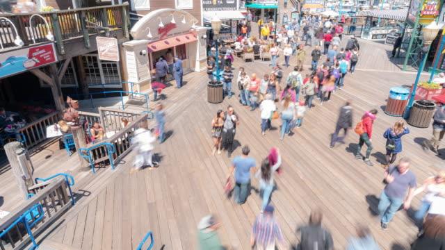 time-lapse crowd pedestrians tourist at pier 39 of san francisco california usa - pier stock videos & royalty-free footage