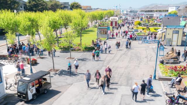 time-lapse crowd pedestrians tourist at pier 39 of san francisco california usa - fisherman's wharf san francisco stock videos & royalty-free footage