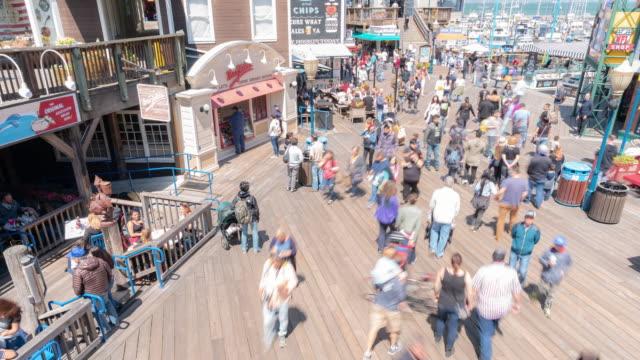 time-lapse crowd pedestrians tourist at pier 39 of san francisco california usa - pier 39 san francisco stock videos & royalty-free footage