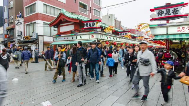 4k time-lapse: crowd people walking at asakusa sensoji temple market in tokyo , japan. - shrine stock videos & royalty-free footage