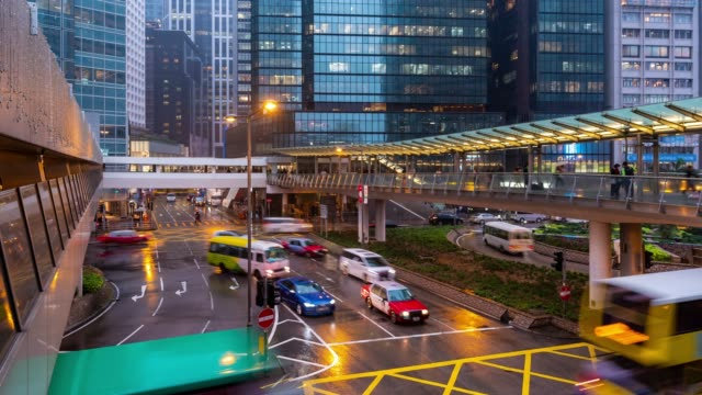 time-lapse: crowded and transportation background in central hong kong downtown at sunset time - traffic light stock videos & royalty-free footage
