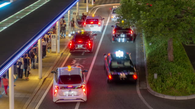 time-lapse: crowded at taxi stand of hakata station in fukuoka city japan at night - taxi stand stock videos and b-roll footage