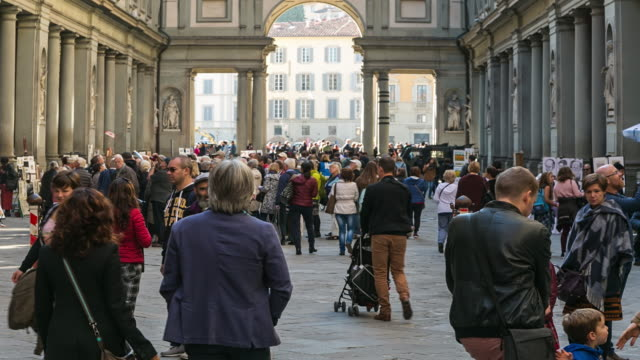 time-lapse: crowded of tourists at the street leading , florence, italy - florence italy stock videos and b-roll footage