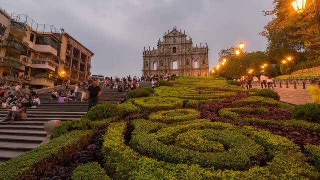 time-lapse crowded pedestrian at ruins of st. paul's cathedral macau - macao stock videos & royalty-free footage