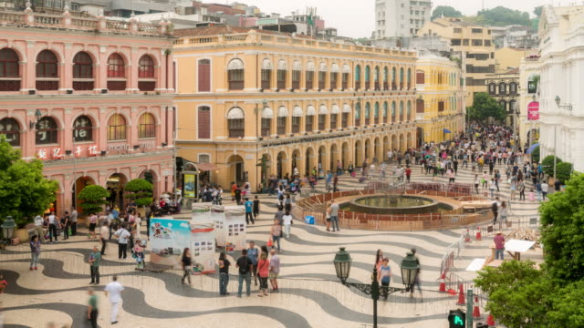 time-lapse crowded pedestrian at senado square macau, china - macao stock videos & royalty-free footage