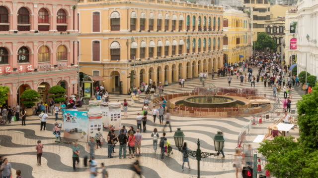 time-lapse crowded pedestrian at senado square macau, china - leal senado square stock videos & royalty-free footage