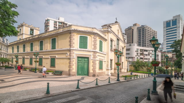 time-lapse crowded pedestrian church of st. augustine senate square macau - leal senado square stock videos & royalty-free footage