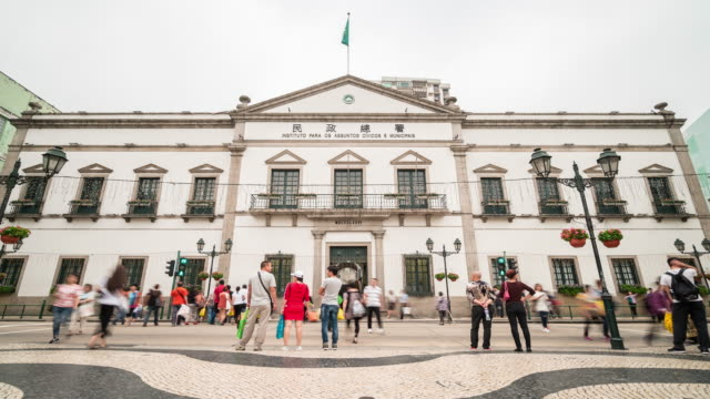 time-lapse crowded pedestrian civic municipal affairs bureau senado square macau - leal senado square stock videos and b-roll footage