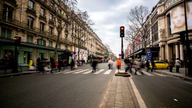 HD time-lapse: Crowded Pedestrian Haussmann Boulevard Opera Lafayette Paris