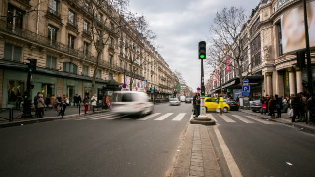 time-lapse: Crowded Pedestrian Haussmann Boulevard Opera Lafayette Paris