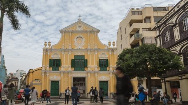 time-lapse crowded pedestrian saint dominic's church senado square macau, china - macao flag stock videos and b-roll footage