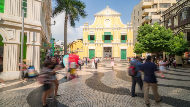 time-lapse crowded pedestrian saint dominic's church senado square macau, china - leal senado square stock videos and b-roll footage