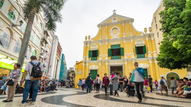 time-lapse crowded pedestrian saint dominic's church senado square macau, china - portuguese culture stock videos & royalty-free footage