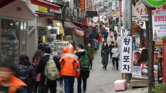 timelapse - crowded people at hongdae street - south korea stock videos and b-roll footage