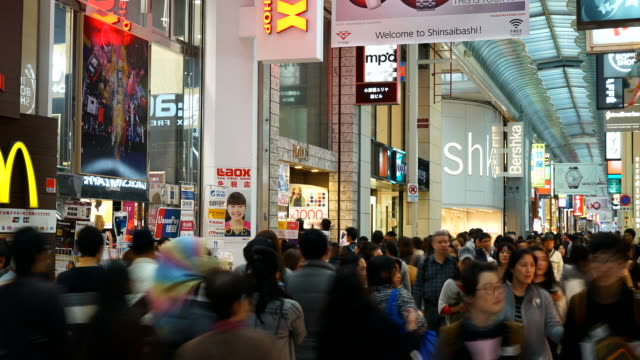 time-lapse crowded people at Osaka night street market in Japan