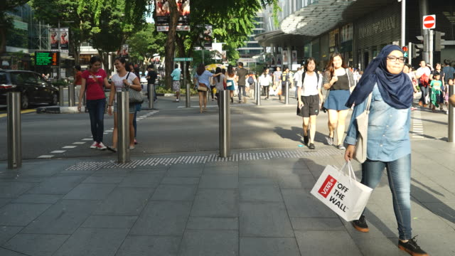 Timelapse crowded people in orchard road at singapore