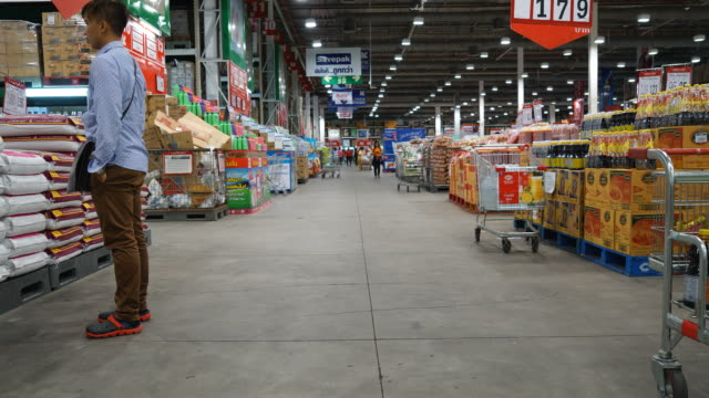 timelapse crowded people in supermarket - aisle stock videos and b-roll footage