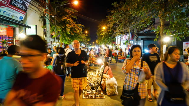 timelapse crowded people walking in Night Market Street at Chiang Mai, Thailand