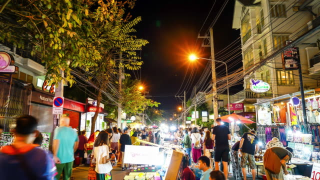 timelapse crowded people walking in Night Street Market at Chiang Mai,Thailand