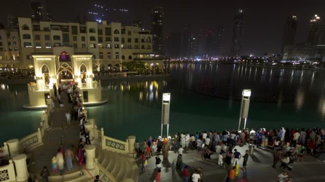 Timelapse crowds and fountains at base of Burj Khalifa skyscraper, Dubai