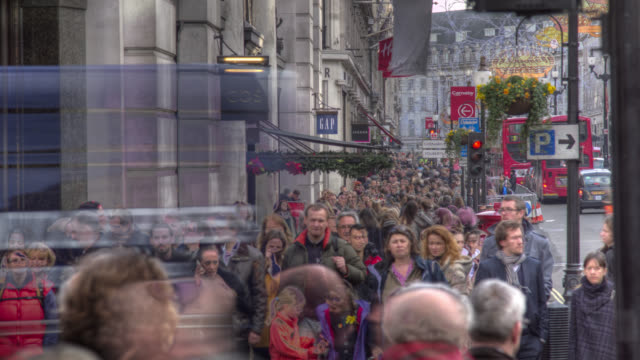 timelapse crowds stream under christmas lights, london, uk - buying stock videos & royalty-free footage