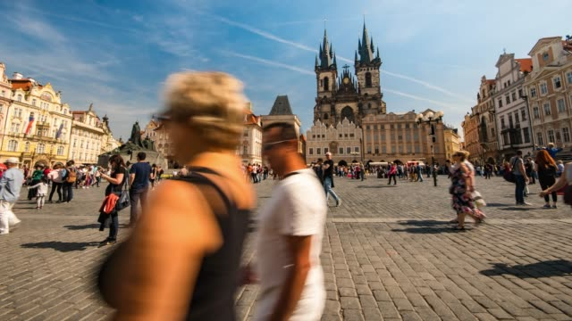 time-lapse: crowed tourists wolking in prague old town square at sunny day - prague old town square stock videos & royalty-free footage