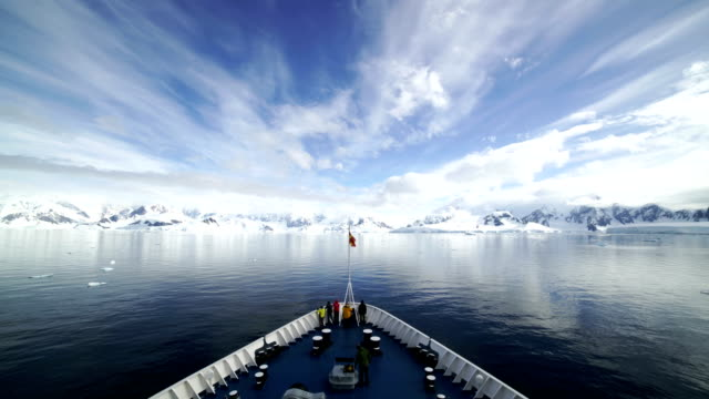 Time-lapse :Cruise ship crusing around ice floes in Antarctic waters