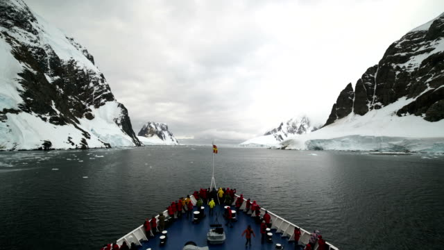 time-lapse :cruise ship sails on graham waterway - cruise antarctica stock videos & royalty-free footage
