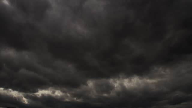 time-lapse dark storm clouds roll toward the camera - storm cloud stock-videos und b-roll-filmmaterial