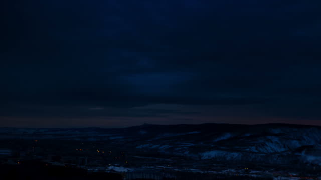 Timelapse Dawn over the city to the river in winter
